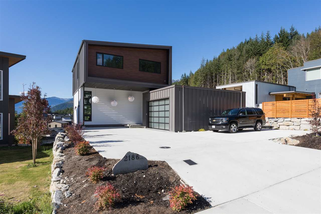 With towering views, this new home in Crumpit Woods is a must-see. All the main rooms have fabulous views of The Chief and Howe Sound, have over-height ceilings and a massive deck to enjoy outdoor entertaining and late-night star-gazing. The living room has a feature wall with plenty of room for your prized possessions. The kitchen will more than inspire the cook in the family; lots of cupboards, gas stove, large side by side fridge & freezer and picture windows. Upstairs are three bedrooms, including a large master suite with a spa-like bathroom, complete with more views and privacy. Downstairs is a large recreation room and a one bedroom suite. Call for your private showing.