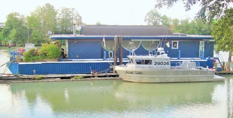 """Rare opportunity! Turn this 80 x 30 barge with a 1462 sf one level home and 487 sf deck with built-in hot tub, into something very special . The house is unique and has some architectural history (modified in 1985 from an office into a house designed by noted Vancouver architect, Fred Hollingsworth). The home is in need of  updating. It is a """"unique"""", """"one level"""" home with lots of upside. Located close to the historic town of Fort Langley, it is moored in a small marina with peaceful pastoral surroundings. Moorage is $1100 per month. All meas. are from 2-the-Point. Appointments & viewings are through listing realtor only. Do not disturb marina residents or go onto property without listing realtor. Viewings by appointment Sat. Sept 9 10am to 11:30am. Call Realtor to book a specific time."""