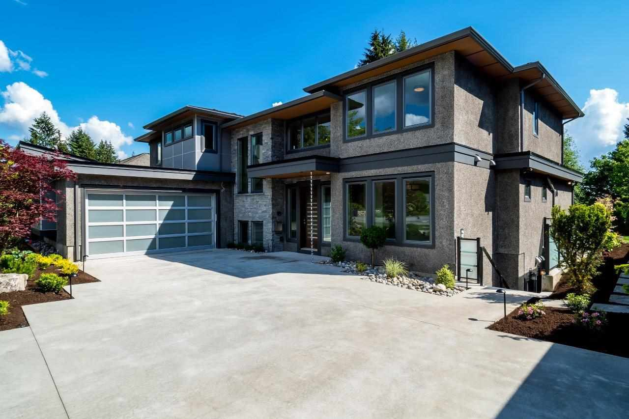 Located on one of Edgemont?s finest streets on a bright 80 X 107 ft south facing lot with no neighbours behind ensuring for total privacy. This stunning custom built 5,185 sq ft home features the ultimate in luxury w/ expansive ?sand on site? h/w floors, high end Sub Zero and Wolf appliances in the gourmet kitchen and secondary wok kitchen. This a great home for entertaining w/ adjoining living, dining separated by a 3 way gas f/p, large family room w/ high ceilings and eclipse doors leading out a covered patio that steps out the rear gardens.  The 3 level residence offers 4 bdrms up (all ensuited) including an opulent master suite with huge ensuite bath, large w/I closet and private deck. Rec room with b/I bar, wine storage, den, gym & optional one bdrm suite downstairs. O Sun Oct 22 2-4