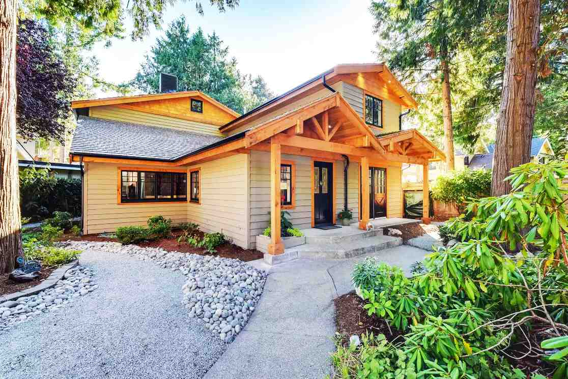 Beach Grove Stunner! Westcoast inspired 5 bedroom residence just steps to the beach, golf course, shopping & great schools! This fully renovated home offers nearly 2,800 sq.ft and will surely wow you at first sight with its vaulted wood ceilings, exposed trusses & a beautiful river rock fireplace reminiscent of a luxury Whistler retreat. Other highlights incl new flooring throughout, new kitchen w high-end Thermador & Bosch appliances, quartz countertops, wine fridge, huge master w dream ensuite & oversize walk in closet, new crystal chandeliers, LED lighting, manicured landscaping and so much more! Excellent floorplan with formal dining room, breakfast nook, upstairs laundry room and extra large 5th bedroom that could be a fantastic gameroom. This is a must see!