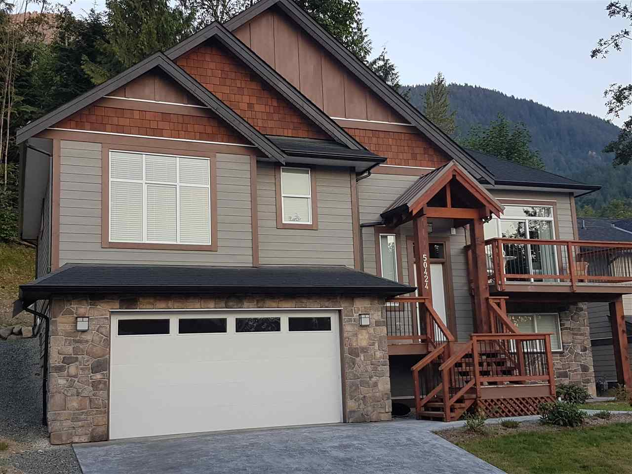 Gorgeous executive new 4 bedroom family home, nestled high in the east hillsides of Chilliwack. This high end build is fully finished and beautifully designed, with open plan, designers gourmet kitchen, bakers size quartz island and counter tops. Quality stainless steel appliances, as well as W/D. Great for entertaining with spacious great room, featured cultured stone fireplace, abundant natural light with the large windows and sliding doors, featuring spacious balcony off the living room. Large bedrooms throughout, 9 ft ceilings, master incl. views to the west , 5 pce ensuite, double sinks, quartz counter tops, custom walk-in closet, built in sprinklers (lower insurance) and nice open concept. Lower level has  inlaw accommodation.
