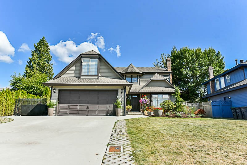 This extensively renovated 2 storey in the heart of Fraser Glen sits on a beautifully landscaped over sized lot with paved RV parking !! The home went through a complete cosmetic transformation in 2013 by Westland Developments and is in turn key condition. Inside highlights include a vaulted foyer, wide plank laminate flooring throughout, dual tone kitchen cabinets w/ stone counters and high end SS appliances, a spa like master en-suite with a stand alone tub, quality mill work, central air conditioning, a huge games room and large bedrooms. Outside boasts a new driveway /walk ways / RV pad, a huge cedar deck and professional designed landscape features encased in river rock. Easy access to transit and Schools. Hurry !!