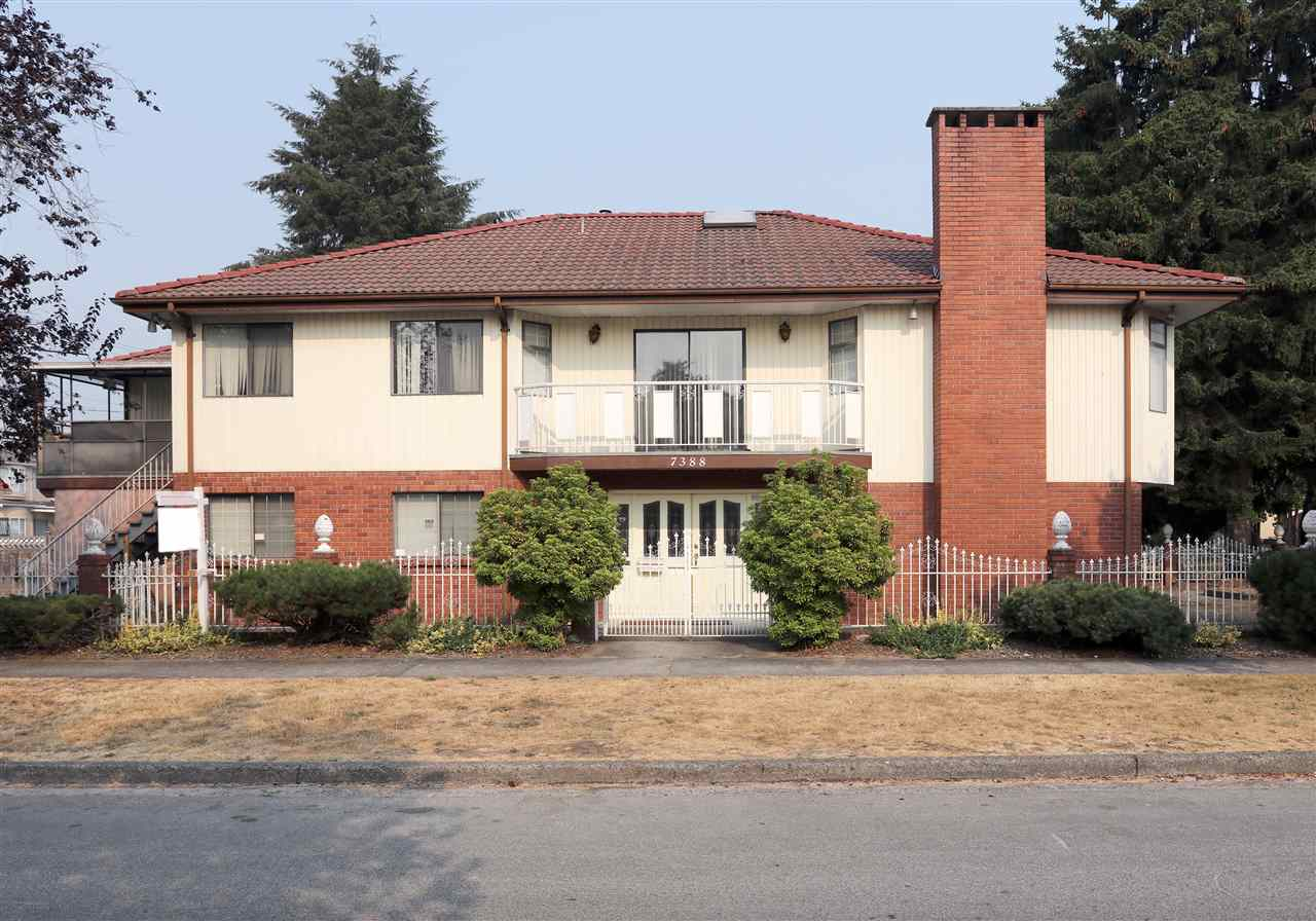 Rare GEM in Prime Fraserview - well kept 2-level Vancouver Special. Corner lot 46'x125' with 3,524 Sqft of living space, 4 bedrooms / 2 baths up, 3 bedrooms / 1 bath down with separated entrance perfect for grannies. High ceilings with lots of skylights, extra big windows, vaulted ceilings with cedar-wood in the living room, wood-burning fireplace with beautiful stone mantle, formal dining room steps to balcony, attached double garage w/gated yard for extra parking. Must view inside to appreciate details. Easy to show. Short walk to Bobolink Park. All measurements are approximate, buyers to verify if deemed important.