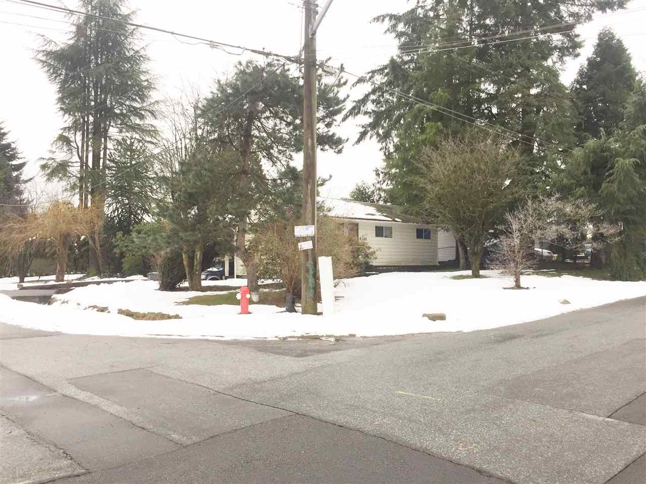 Large RECTANGULAR, CORNER property on a quiet street surrounded by newer homes (LOT 9362 SQFT). Great opportunity to build your dream home. Two blocks from the bus stop with fast easy access from this location to highway, City Central & Sky-train to downtown Vancouver. (small right of way on corner of lot). Excellent value - bring offers!
