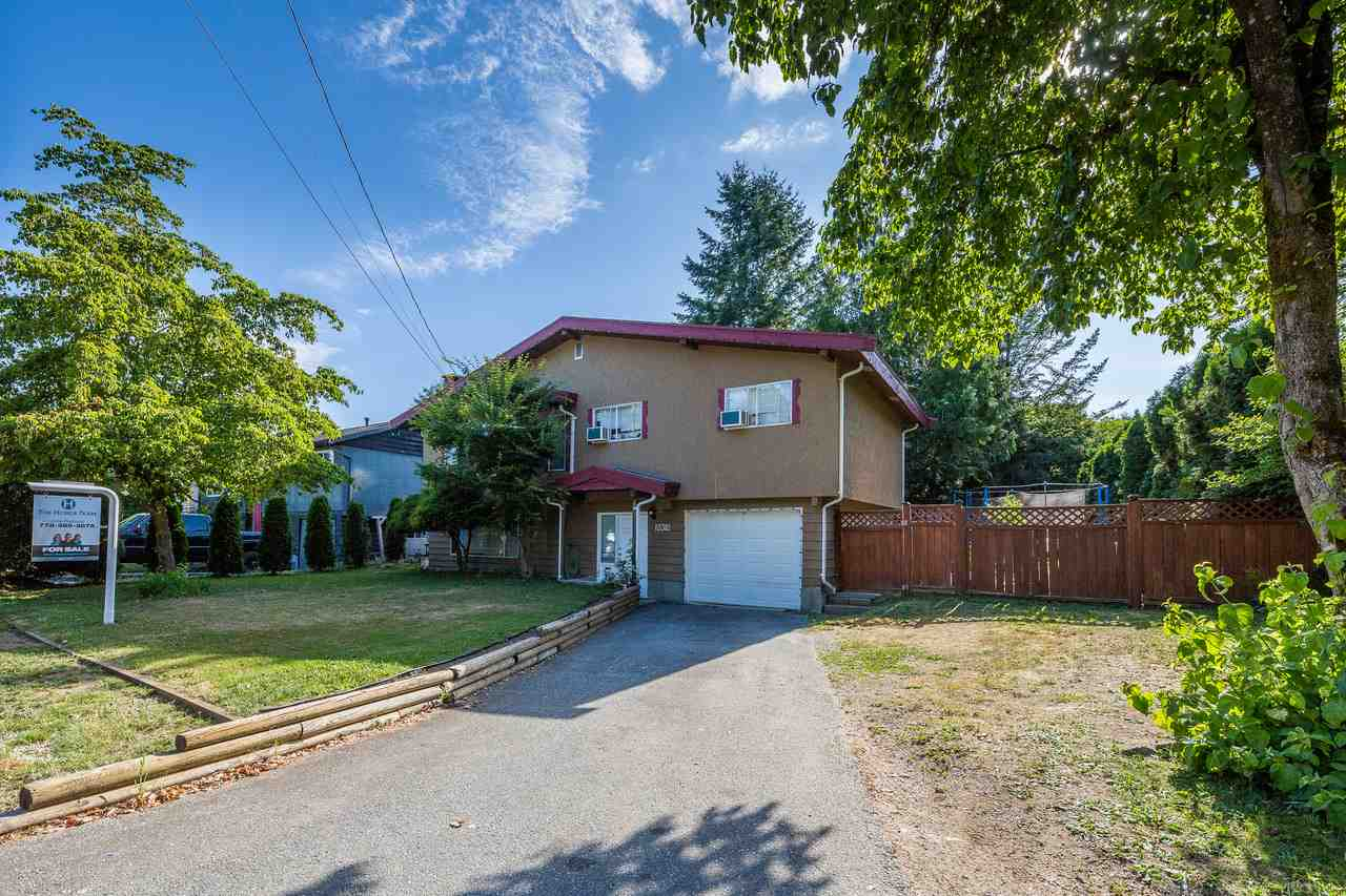 Unique opportunity in desired West Maple Ridge. This lovely family home is just over 1800 sqft, 4 bedrooms, large recreation room, storage & large eat in kitchen area. Basement could be easily suited. All this on large 9400 sqft lot. This property can be purchased with adjacent property to the north. City indicates support for development. (Single family, duplex or new triplex zoning is a possibility. Contact listing agent for information or to schedule a viewing.