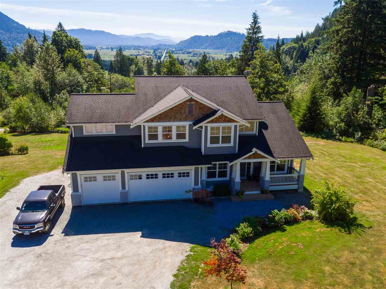 Beautiful custom built family home on 38.8 acres with an incredible view of mountains out each window. This home features solid scraped hardwood flooring, oversized windows, south and west facing wrap around decking, very efficiently heated and cooled via heat pump, on demand hot water and back up generator just in case. The bright open kitchen has a great eating island a generous pantry all with stainless appliances. The land is double zoned and partially in the ALR which results in ridiculously low property taxes. The endless natural water spring provides you with possibly the best drinking water anywhere. Just imagine the trails or camps you could make on the treed back 20 plus acres, or start a Xmas tree or blueberry farm.