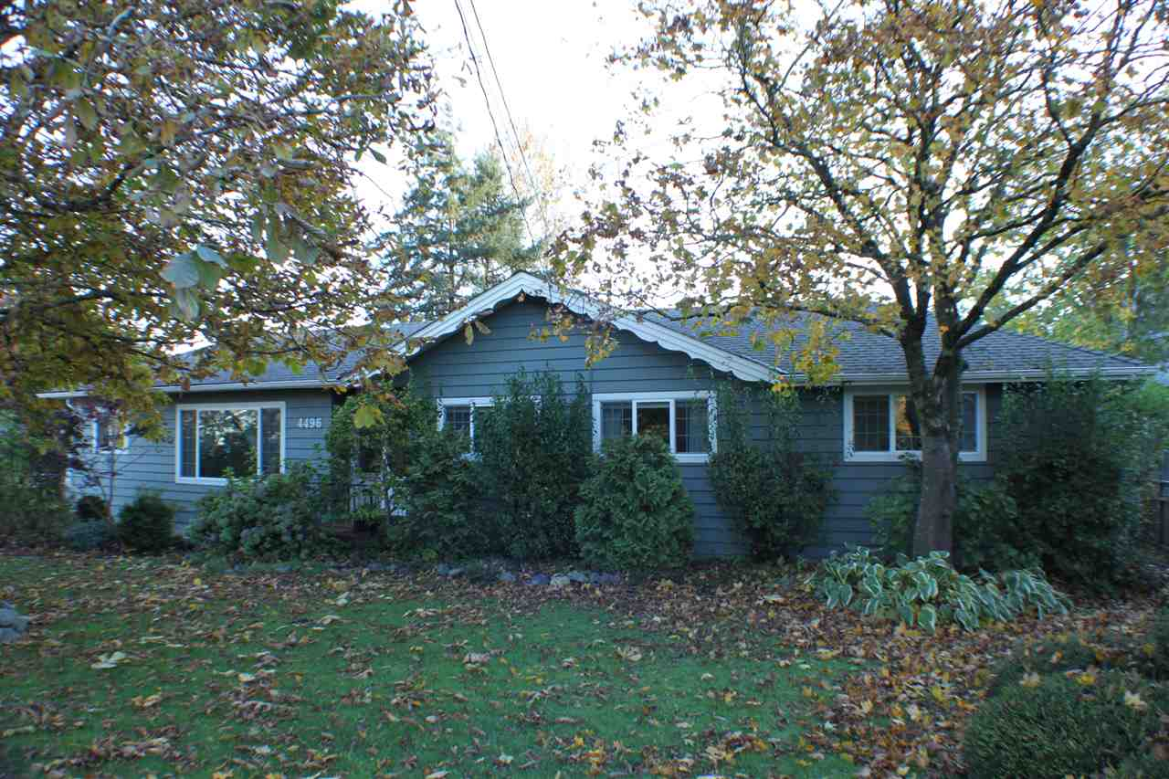 Here is your chance to enjoy a comfortable, well maintained 4 bedroom (plus Den & Office) family home on 1.25 flat acres in the Village of Yarrow. Upgrades include 2 furnaces, electrical, plumbing, vinyl windows, appliances, countertops, roof (5yrs old), and a brand new h/w tank. The septic system has been upgraded with a pump chamber and new field. There is a wood burning, airtight stove. The exterior of the home was painted in Summer 2017. 750sqft, 2 storey shop, greenhouse, other small buildings. The field and back yard are fenced and have views of the mountains. Fruit trees, berries, grapes, kiwis, and flower gardens enhance the property.