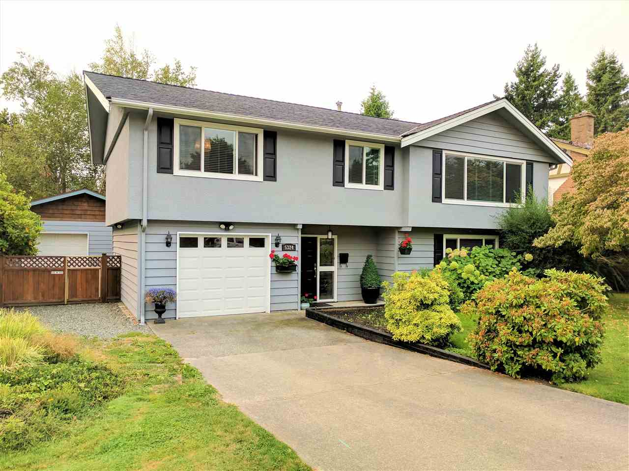 Lovely 4 bdrm family home located on a 7000 sqft lot in one Tsawwassen's most desirable neighbourhoods. This 2000 sqft home has been professionally redone & features a bright, modern new kitchen that overlooks a large south-facing deck & backyard, updated bathrooms, new roof, custom built-in shelving units, new hot water tank & windows, custom blinds, modern lighting fixtures, fresh paint inside and out plus beautifully refinished original hardwood floors. Perfect for a young, growing family this home is immaculate & move-in ready. In addition to the single car garage, this home also features a bonus 600 sqft detached garage w/ 220 wiring for the hobbiest, craftsman or for additional storage. Just a short walk to Pebble Hill Elementary & Diefenbaker Park...excellent home - don't wait!