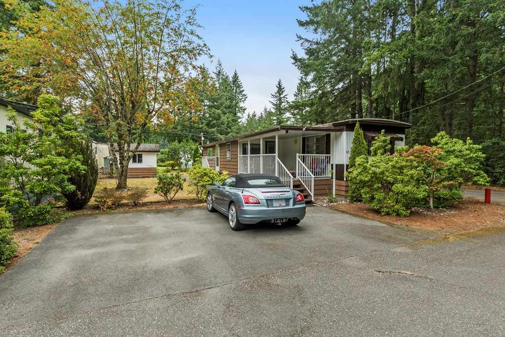 Fernridge Park- Majestic location peacefully set in private park setting with only neighbours on one side. No need for a car as  very close to amenities, groceries, pub, gas station & pizza. Campbell Valley Park & Brookswood just a few minutes away. Well kept unit that feels so much bigger then it is, 1 BDRM & DEN could be 2nd BDRM, large living room & family room. Kitchen &  bathroom updated a few years ago. Storage shed, large front sundeck, & parking for three cars come with this unit. Park has a outdoor pool & amenities building. Water, sewer, garbage pu, mgmt & taxes on the land included in $499 pad rental. This little gem waiting for you.