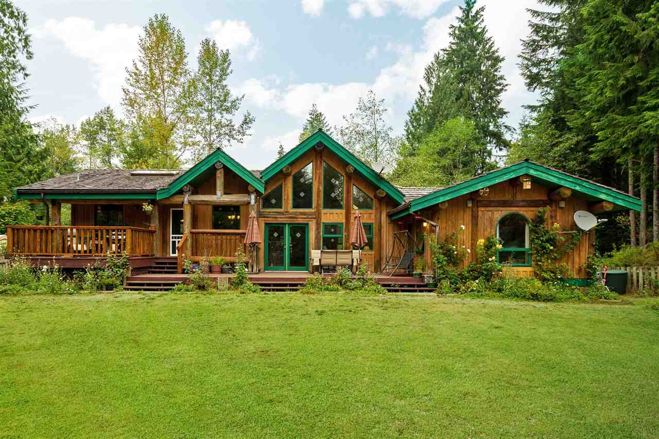 2.37 ACRES WITH BEAUTIFUL Post & Beam LOG HOME! Rancher w/ Walk-out basement. Main floor includes: wood-burning high efficient stove, vaulted Cedar ceilings, thermo windows, patio and decks, Open kitchen layout, Large master bedroom w/ walk-in closet, 5 piece luxurious bthrm, spare bdrm, an office, laundry rm w/ ext. dr, eating area & open kitchen w/ grand island. Basement includes: 2 bdrms, rec-room, 4 piece bath, eating area and a kitchen w/ exterior dr/patio in the in-law suite. The front and back yard are well landscaped including private yard, with a hot tub, fire-pit, and wood shed. As you enter the long, slightly winding driveway there's a foundation w/ Quonset so build a shop, barn or garage! Septic. On city water! Propane gas (tank leases 151 a year) Cell service is now in area!!