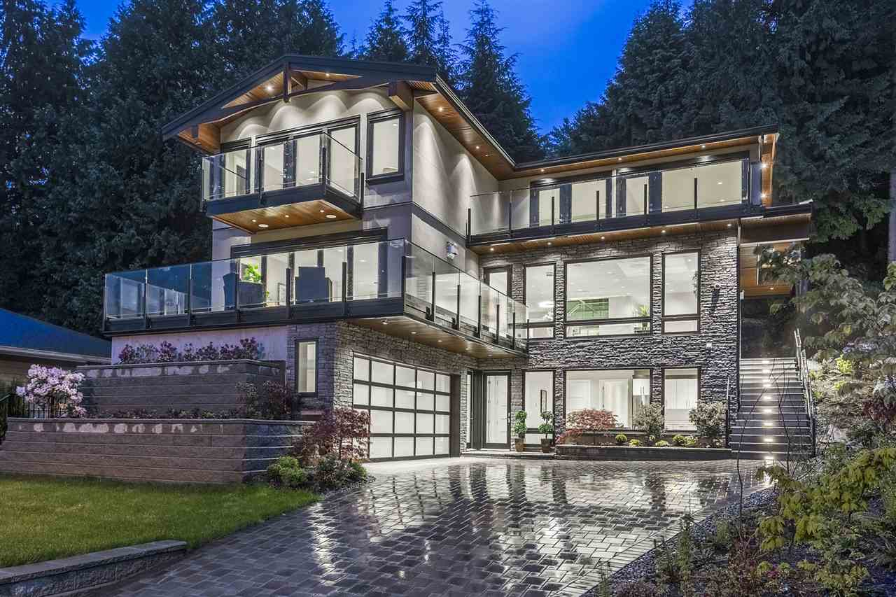 Extremely attention to detail custom-built quality brand new home with amazing Mt. Baker and city view! Walking distance to private Collingwood School Senior campus, this magnificent dream home sits on 13,284 sf lot, spacious open concept main level features high ceiling, gourmet chef?s kitchen, wok kitchen and office with separate entrance. 4 bedrooms up all with ensuite bathrooms and balconies, 2 bedrooms down (above around) includes 1-beroom suite for in-laws or guest suite, wine cellar, wet bar and theatre room for all your entertainment needs. Meticulously detailed with top quality materials throughout including excellent millwork, smart home system, security system with cameras 24/7 surveillance, radiant heat on all levels with 8-zone temperature control, air conditioning, HRV, Euroline windows, custom chandeliers and lighting, Miele appliances, natural stone countertops throughout, built-in central media control/speakers, central vacuum, 4 gorgeous fireplaces, 2-5-10 years New Home Warranty & much more!