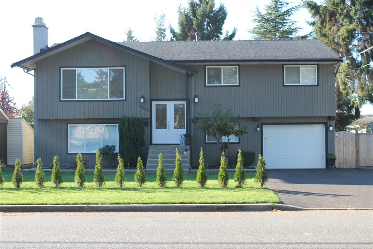 Own this meticulously decorated 2-level home in Ladner's desirable Port Guichon area. Enjoy the updates in this perfect family home on a huge 8,116 sf west-exposed lot. Easily re-suited and close to elementary and secondary schools. Some of the gorgeous renovations include an open concept design; kitchen w/ huge island & LG appliances, new bathrooms and laundry room, new laminate and tile flooring, flat finish ceilings, recessed lighting, new windows, new plumbing, upgraded 200 amp electrical, built-in vacuum, surround sound, mouldings and doors, new Valor fireplaces, upgraded insulation, new fence and paved driveway/parking and much more ... zoning allows a new build of 3,436 sq ft. Act fast!