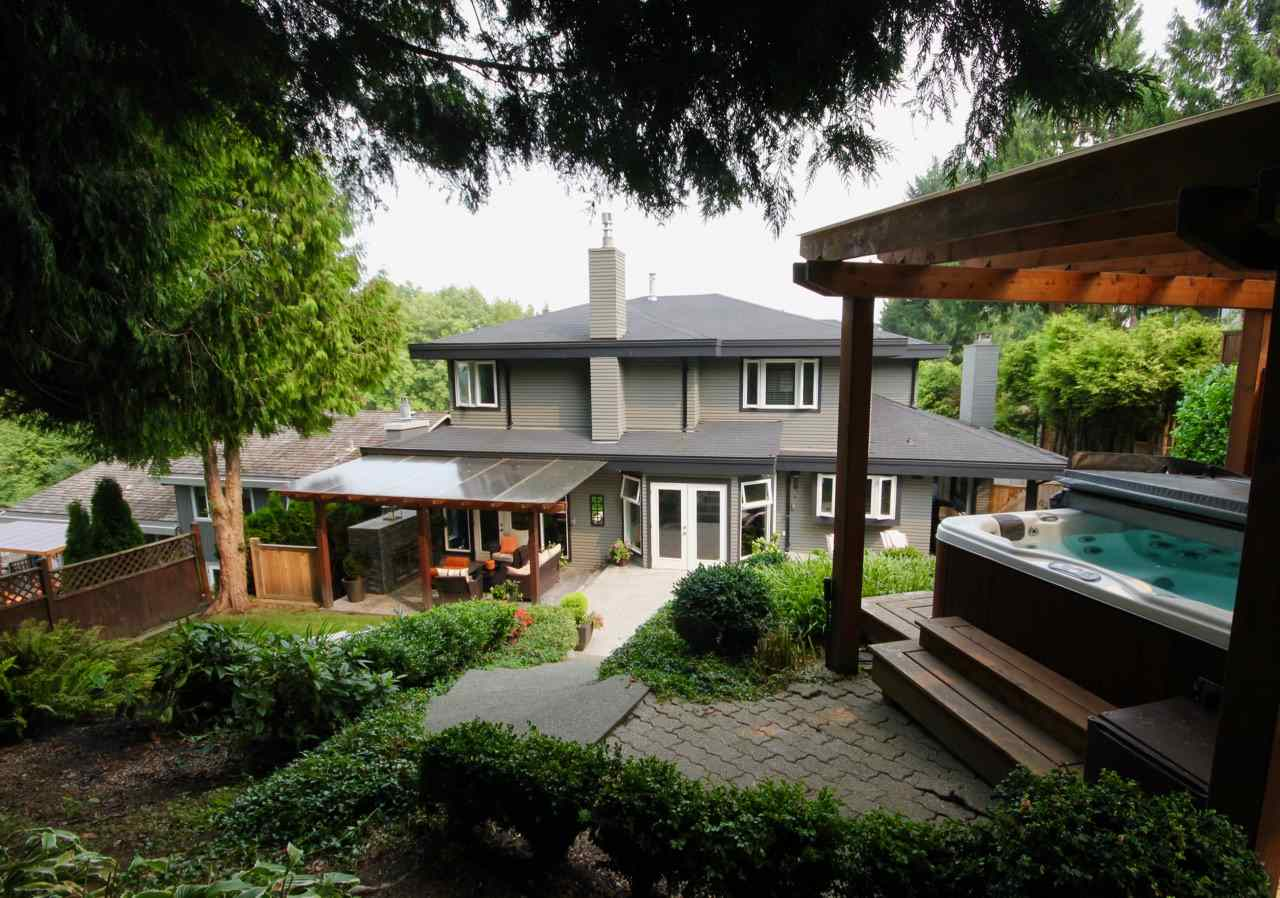 Stunning 4,822 sq.ft quality built west coast inspired home in Tsawwassen?s coveted neighbourhood ?The Terrace?. This bright and spacious 5 bedroom executive home has been renovated to show like new. The Impressive architecture offers vaulted ceilings with an abundance of sky lights that draw in natural light and great flow with a combination of open living spaces and spacious principal rooms. Large gourmet kitchen with over-sized quartz island, and professional appliances including a capital pro gas range and wine fridge. Oversized master bedroom with a luxurious en-suite and custom walk in closet. Fully finished basement with huge 1000 sq.ft media room, a home gym and sauna!  Situated on a beautifully landscaped 9,041 sq.ft. property you?ll find a private backyard complete with a covered outdoor living room with fireplace, waterfall, and steps leading up to a covered hot tub. Truly an outdoor oasis perfect to enjoy year round.