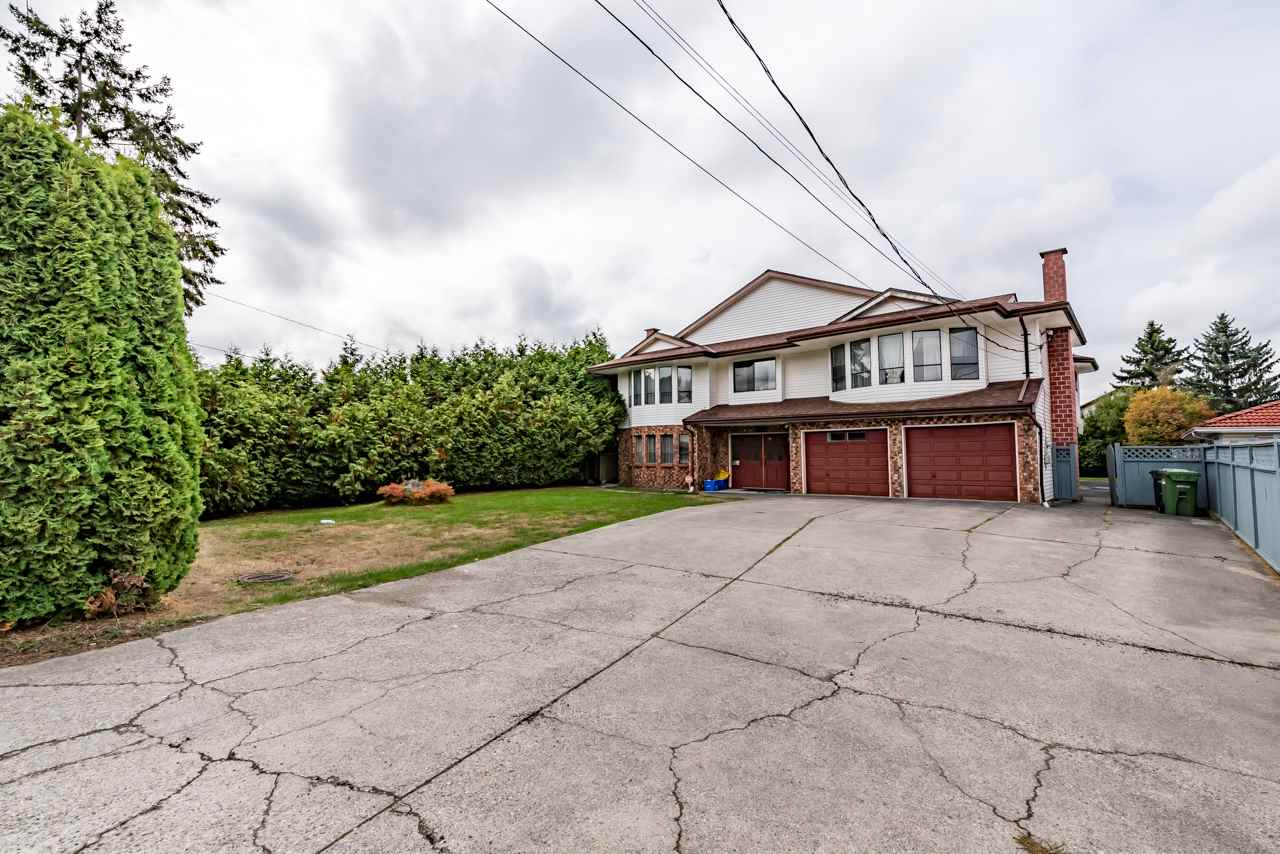 Huge lot 66'x184'5 and 2 level huge house 5,305 SF, close to No 4 Rd and Blundell. Total 6 bdrms & Den, 4 full bathrooms, sauna room, double garage. Downstairs 2 bedroom in-law suite with separate entrance & laundry, high ceiling foyer with spiral staircase, 3 fireplaces, big sundeck & backyard, all the rooms are very big, hot water baseboard heat both floors. Recently updated roof, paint & hot water tank. Owner kept the house in very good shape. Walking distance to mall, bus & school. Potential Townhouse Development Site with adjacent properties. Golden opportunity. Call today.