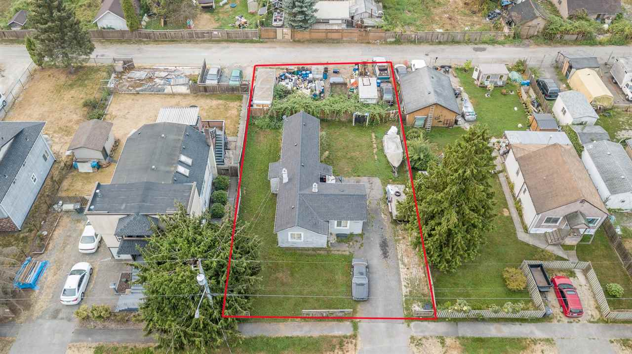 Are you a builder / developer looking for your next site? This property offers a large lot (8,821 sf) w/ back lane access, great frontage and lots of depth. Whether you are looking to build now or in a couple of years, this property offers solid value for today and incredible holding value for tomorrow. The home is old but has a 1 yr old roof, newer furnace & newer floors. Great rental opportunity for both the home and the back of property which is currently rented out to a long term tenant, a scrap metal collector. You can't beat this location: public transit just out the front door, a park just down the road, quick access to HWY 17 and new businesses all around. A few neighbors have already re-built and more are in the works.