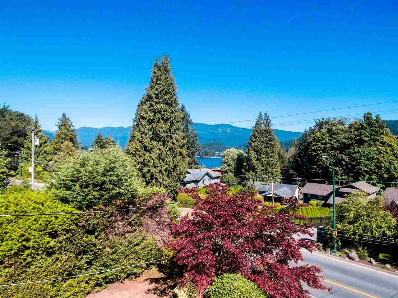 Multiple opportunities knock here!  With lovely mountain & ocean views, steps to Cates Park and minutes to everything that the vibrant and diverse North Shore has to offer. It's brilliant. The 11,868 S/F property sits high above Dollarton and backs on to Fairway Park--a blank palette for the landscaper in you. The  home has great bones (needs TLC), attractive west coast architecture & the versatile post-and-beam construction lends itself to an open-concept renovation. The Main Floor is 1700 S/F and features two large decks, perfect for entertaining. Lots of available FSR so a large addition is possible. Build new, around 6000 S/F possible. AM amazing opportunity either way.  Showings By Appointment Only.