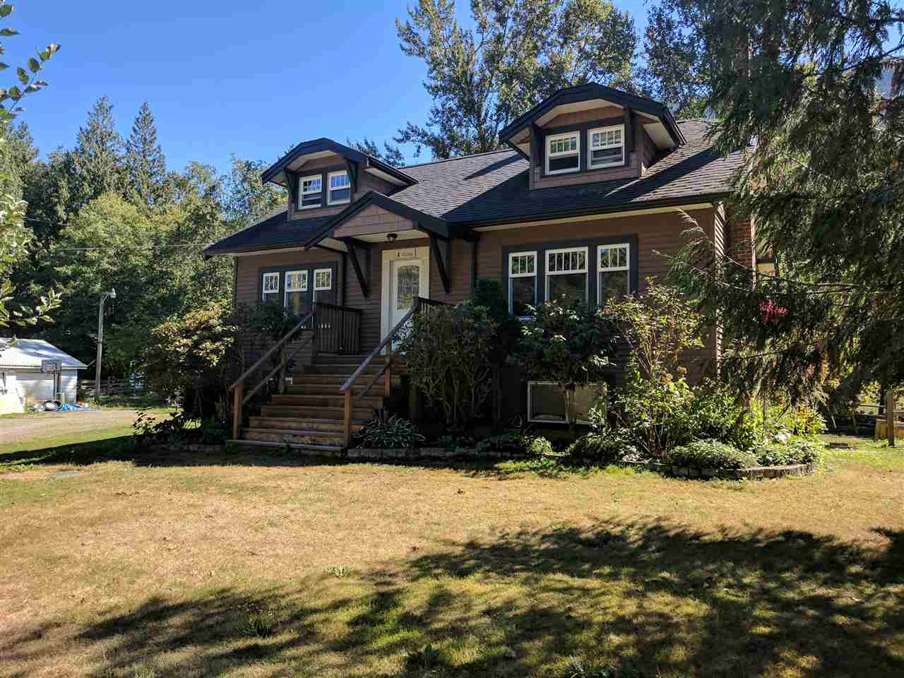 An opportunity to own a heritage style character home on Majuba Hill. This home has retained it's unique heritage character with unique architecture and original hardwood flooring while offering a number of upgrades including a gorgeous country kitchen with granite counters, newer windows, furnace, roof and vinyl siding and septic system. Set on a private 3 acre lot with a horse barn, paddock & riding ring with a creek meandering through. Very desirable Majuba Hill location with the potential for a carriage home. Call to view now.