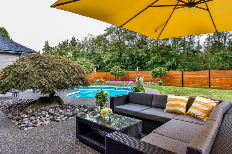 Fantastic family home in Deerfield, one of the best locations in Tsawwassen. This extensively updated, spacious home has a great layout with 4 bdrms, 3 full bathrooms, formal living room with f/p, beautiful open great room concept with large Island. The kitchen, family room and rec. room all overlook the pool, garden and putting green. Minutes to the beach, schools, transit, Tsawwwaassen Mills, ferries, but still complete privacy as this home's special location backs onto Point Roberts Golf Course, WA State. Enjoy entertaining or just relax and watch soaring eagles in your newly fenced, gorgeous yard. This home is a pleasure to show.