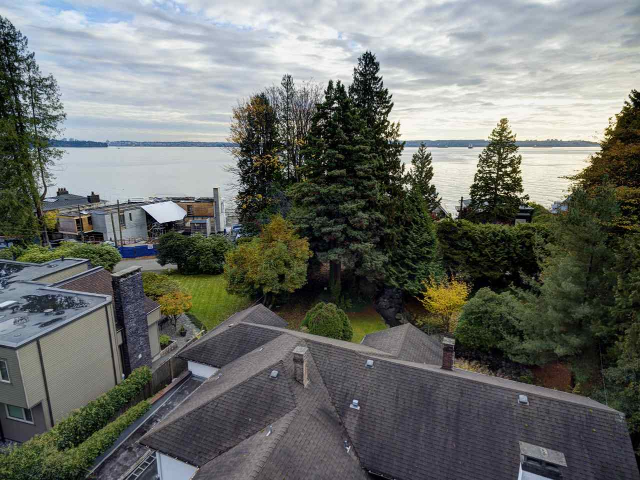 SPECTACULAR SEMI-WATERFRONT OPPORTUNITY! The Golden Mile of BELLEVUE AVENUE! Build your dream home now (approx 6000sqft) or hold for future possibilities. Situated at the end of a private & stately 17,000 sqft+ property. Environmental Report, Topographical map & new Survey available. Glorious natural landscape amidst old rose gardens and a storybook creek. Older existing home with large principal rooms including the 30ft living room with gas fireplace & sunroom & 20ft dining room with gas fireplace. Large galley kitchen & family with gas fireplace opens out to private gardens. Master bedroom plus second bedroom and den/bedroom complete the main floor. Lower level consists of a recreation room with fireplace, games room, 2 bedrooms, greenhouse & 20ft workshop. Walking distance to Dundarave By The Sea, Preschool, Dundarave Village, Dundarave Beach & Seawall. Close to West Bay & Irwin Park Schools, West Van Rec Centre, Swimming Pool & Ice Rink.