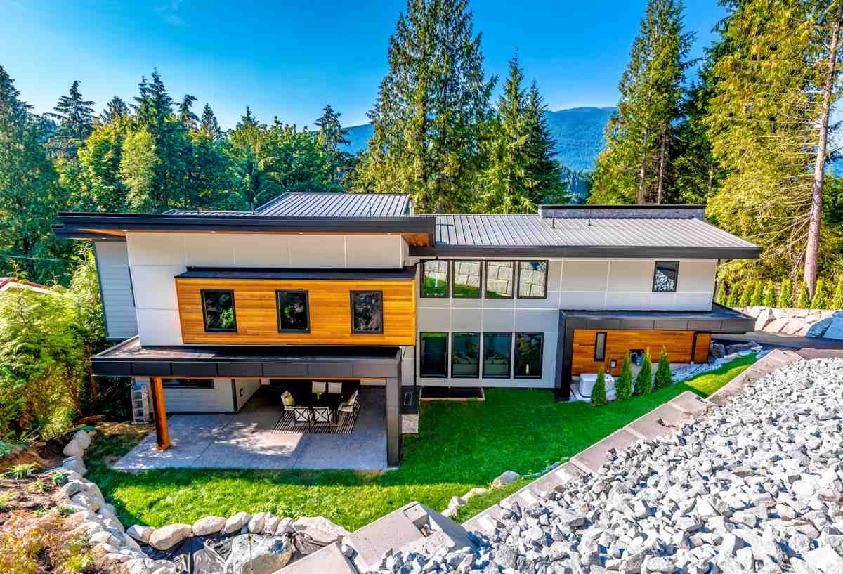 BRAND NEW ultra-modern Luxury Home in a perfect West Coast setting OVERLOOKING the OCEAN in beautiful Belcarra.�Nestled in nature on a 21,384 sq.ft. lot with picturesque views this open concept 5 bdrm, 5 bath custom home by Zed Studio Design features 4,200 sq. ft. high-end�finishing throughout. Every detail selected is both dramatic, yet elegant.�The stunning gourmet kitchen is a entertainers dream with a large centre stone island, a Brizo mount pot filler, 64? wide s/s freezer fridge & over sized wok kitchen complete with a wine bar. Rich features include resplendent engineered hardwood flooring, Marvel Legacy Vintage Edition stove, reclaimed wood open staircase, post and beam elements, 21ft. floor to ceiling windows take in ocean views and natural light while the tilt and turn sliding glass doors the dining allow seamless indoor/outdoor living with over 1,000 sq. ft. of patio space including covered areas with outdoor fireplaces to be used year round.