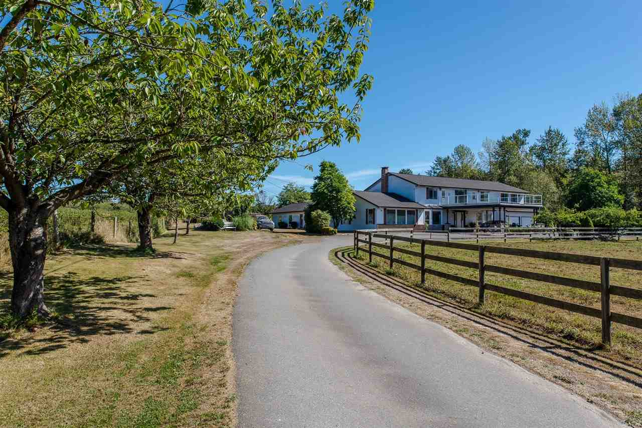 Amazing investment cashflow potential! This massive 18.64 acre property has an abundance of farming w/ privacy. Enter the gates as you pass original house perfect for farm help or renters. Next to that a working horse facility w/ 1,587sq ft stable, Indoor Horse Arena: 10,629 sq.ft. and 520sq ft shop w/ loft. Keep driving you pass many fields & situated at the back of the property is a 4944sqft main residence. 50yr roof. French country formal living & DINRM easily connects to a sprawling gmsrm w/bar. Upstairs has 4 oversized bdrms. Solid 2x6 construction w/ some updates & situated w/ view of Mount Baker! Outside area has wood fired outdoor bread/pizza oven w/endless yard. Property runs east-west rectangular shape & great for farming such as blueberries or vineyard! indoor pool main house