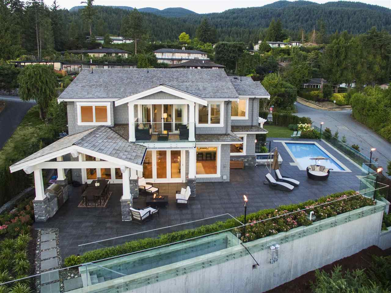 "QUALITY! QUALITY! QUALITY! Sensational ""Custom"" Built Home w/unobstructed view from Lions Gate Bridge/Down Town/Stanley Park to UBC & Van Isld! Built by renowned German Builder, Ron Osterman of Can Rel Homes, this amazing home boasts extraordinary workmanship throughout. Main: flat driveway, grand foyer, 16ft vaulted ceiling, stunning great-rm, formal dining rm, prof gourmet kitch, roughed-in WOK kitch, 3 10ft folding drs opening to expansive covered patios, outdr BBQ/Music & cov'd swimming pool/hot-tub. Upper: Oversized master w/elegant en-suite & walk-in, plus 2 oversized en-suited bdrms w/walk-ins. Lower: 10 ft ceiling huge rec/media rm, large en-suited bdrm, gym & fab wine cellar, Ideal home for entertaining! A MUST SEE!!!"
