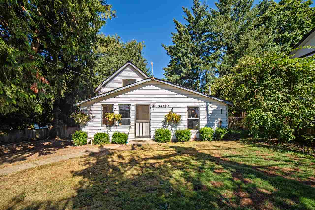 You will love this massive 11,000+ square foot lot on a fantastic street in prime Hatzic Bench. This is one of the original homes on Ferguson - one of the nicest streets in the area. There was an addition in the late 1980s. You will find a bedroom and a den on the main level. Gas fireplace in dining room. Master bedroom has a full 4-piece ensuite. There are 2 good sized bedrooms upstairs. 2 separate basements; one is part of the addition, the other is part of the original structure. The home has huge potential but could use some tender loving care.