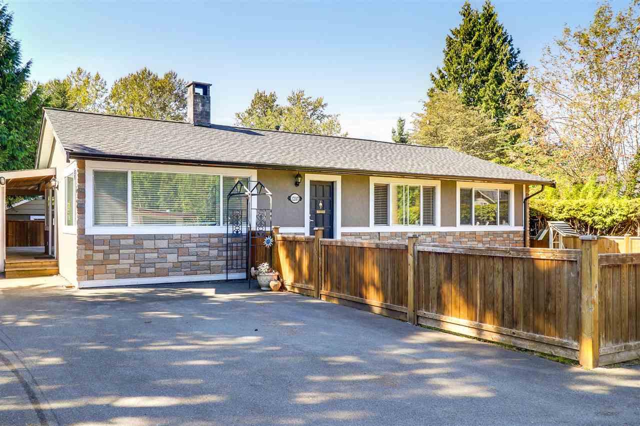 Beautiful 1200 sq/ft rancher on a 6080 sq/ft fully fenced, flat lot on Cul-de-Sac in the heart of Maple Ridge! Everything from the ground up has been redone including floors, kitchen, appliances, windows, roof, furnace, hwt, wiring, soffits, gutters, drainage, fencing, rear deck, siding & so much more! Kitchen boasts Granite countertops, ss appliances, undermount sink, gas stove, tons of cabinets & island w/eating bar. 4 pc bath features radiant floor heating! $4000 air tight wood burning insert w/blower heats entire house. RV parking & powered workshop for the handyman. Huge entertainers deck off kitchn w/ gas line to the BBQ! Great holding property for future development! Walk to No Frills Grocery, Starbucks, Sushi, Walmart. 1 Block to Transit.