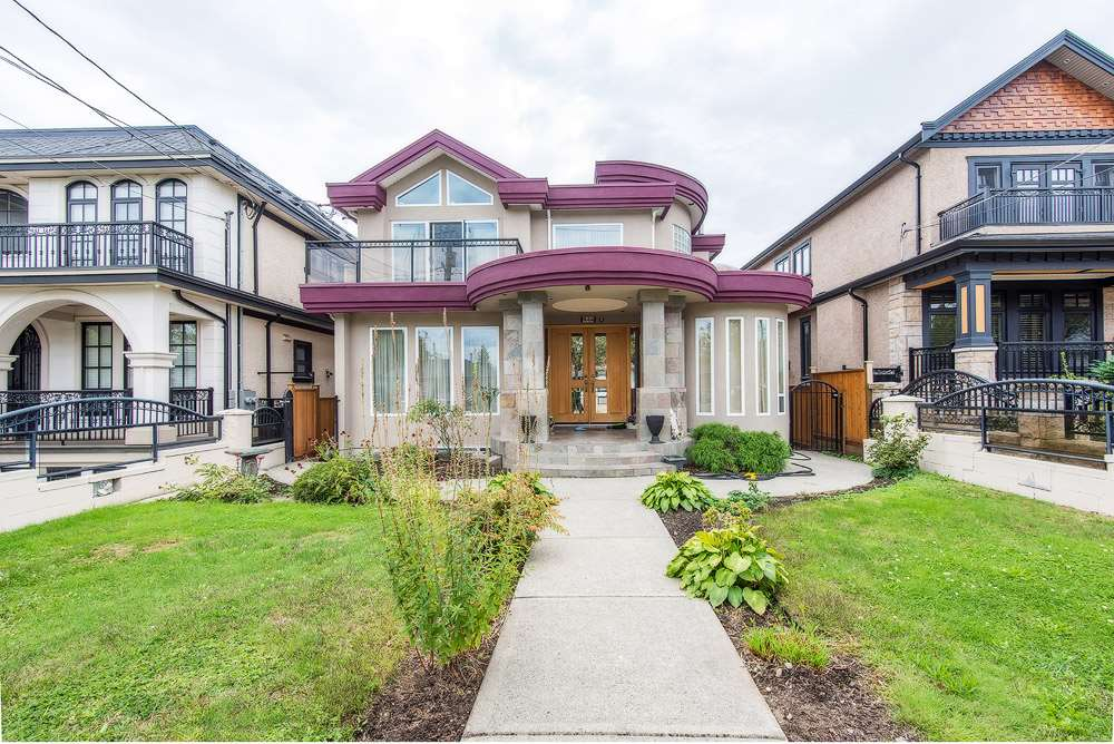 Rare opportunity to own this 5064 SF mansion on 8575 SF Huge lot in South Vancouver. Custom built with vaulted ceiling and 5 sky lights make inside shine. Luxury open kitchen and spice kitchen, 3 car pot garage. Separate entry for two and one bed room unit at basement. Amazing view of Richmond over the huge deck and upstairs bed room . Wide and deep backyard offers you plenty space for seasonal outdoor activities and gardening.   Additional value to have big unusual plant  monkey puzzle tree. Desirable convenient location and community, minutes away to sunset community center. Transit, shopping, school are all steps away. Open House Sat Oct07 2:00-4:00