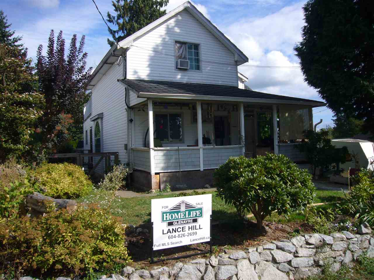 HERE'S A GREAT OPPORTUNITY. Heritage Style House with a Large Covered Front Porch. 3 bedrooms on the main floor, plus a 1 bedroom suite above with a massive 14' x 25' deck and a basement for storage. Situated in a great location and is an easy walk to all levels of schools, the recreation center and play fields. Bonus, the back yard is accessible via a lane. This is the affordable home you have been looking for. Call to see your new home today.