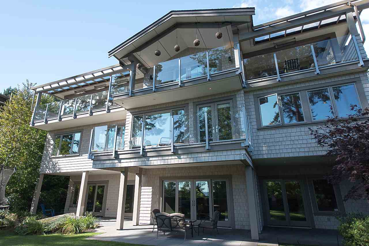 Elegant Bayridge Custom Built Home by Georgie Award winner G.D. Neilsen Developments & NO GST!! Stunning South facing ocean views from all rooms in this tranquil majestic oasis!! Amazing brightness in this unique & modern designed 6,498 Sq Ft plan on a quiet cul-de-sac, 1/3 acre lot. Home situated to maximize privacy from all terraces & backyard. Spa like Master with his/her WIC, 5 Ensuite bdrms, 4 bdrms on 1 level & 2 bdrms on other level. Fabulous flow, open concept, Vaulted Ceilings, Office, Gourmet Kitchen with high end SS appliances, dining, BBQ area, Theatre & Rec room. Pella wood windows & doors, cozy radiant heat & lots of storage. ADDED: Heated Sunroof, Bathroom, WIC, appliances & storage. Nature lovers will love the peacefulness of the beautiful forest and lush landscaping.