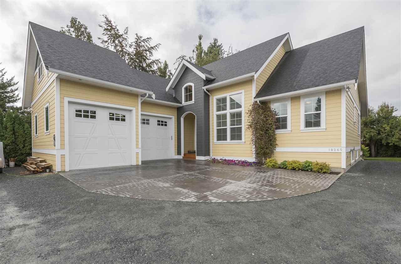 Amazing 2013 3100sqft custom home on 1/3 acre lot! Built to high standards by a warrantied builder for himself and his family, this open concept home with modern finishing features 5 bdrms+den, vaulted ceilings, real hardwood floors and 12'x40' covered fir patio w/ hot tub. Master bdrm is located on the main floor with a large en-suite. Home also includes a 570sqft shop with heat, A/C and 10'x10' doors. Large 5' crawl space has excellent access either from inside the home or through windows on either side making this house a storage dream. Lot is roughly 275' deep with ample parking for all your toys. Super private back yard for the kids and walking distance to elementary school. Close to the Fraser River for fishing and outdoor adventure. Don't miss out on this estate style property!