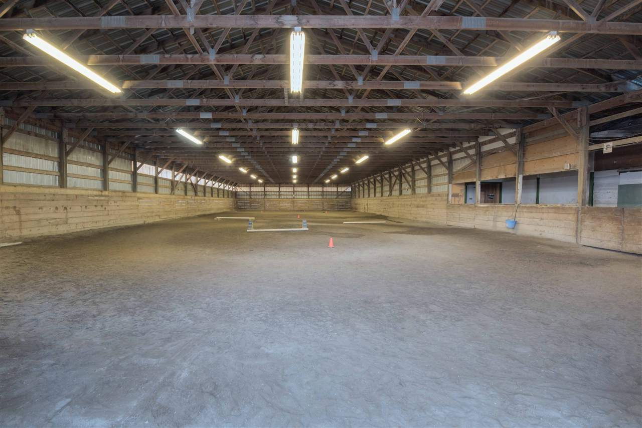 10 ACRES SET AGAINST THE MOUNTAINS COMPLETE WITH EQUESTRIAN FACILITY AND RENOVATED HOME WITH ROOM FOR EXTENDED FAMILY.18 stalls with mats and water,some with runouts,80x160 sand outdoor ring-66x150 indoor arena-round pen-grass turnouts with water-all fenced x fenced and well drained-no hog fuel-cement manure storage-washroom with laundry-storage lockers. Ready for business.Home is renovated nicely with room for all family members and large decks to enjoy the privacy of your own counrey estate.Ample parking and country chicken coop for farm fresh eggs.10 mins to Abbotsford.Could not replace for this price-pride of ownership will make you want to move right in.Call today for a private tour.You will be impressed.
