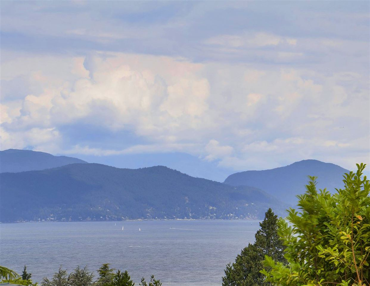 An outstanding opportunity to build a home embracing unlimited luxury. Rarely available prime freehold flat building lot in the prestigious University Endowment Lands. Private 100'x204' boasts both stunning water & North Shore mountain views. Close to UBC, easy access to all amenities and to Vancouver's city centre via 4th or 10th avenues. Close to Spanish Banks, Locarno, Jericho & Kitsilano beaches, Pacific Spirit Trail, public & private golf clubs, public schools & some of BC's most prominent private schools. The 3632 SF home may be rented providing opportunity for future investment return. However, the property's value is in the land. SF-2 Floor Space Ratio shall not exceed the lesser of .25 of the site area or 7000 sq ft. Potential Buyers must verify.