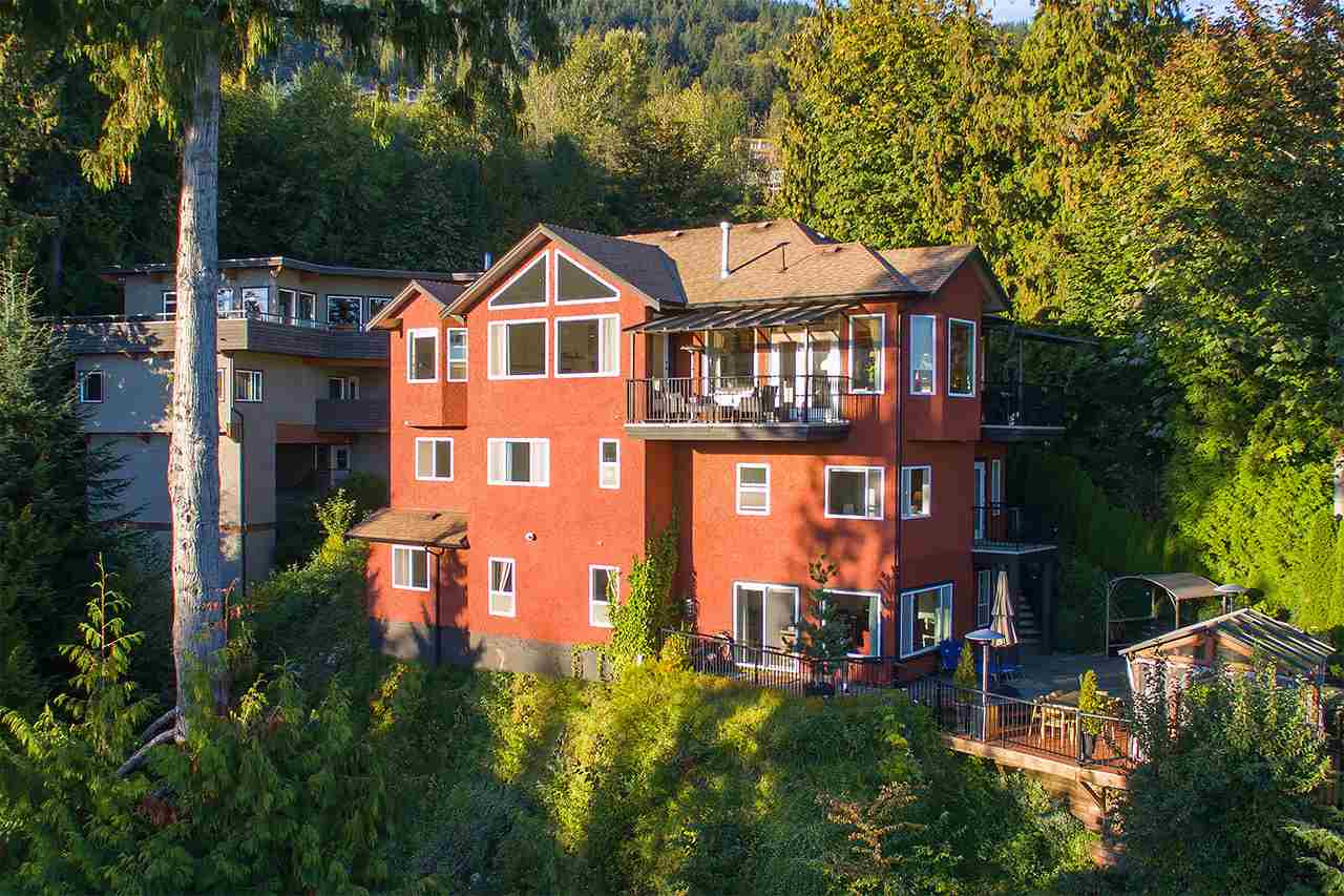 SENSATIONAL FAMILY HOME W/ STUNNING OCEAN VIEWS OF KITS, UBC & VAN ISLD. Build with exceptional quality and attention to detail, this amazing home boasts great floor plan featuring grand foyer, fantastic gourmet kitchen w/ S/S appliances, spacious family room, den and sunken living & dining rooms. ALL OVERLOOKING THE INCREDIBLE VIEW! Middle floor: over-sized grand master w/ ensuite, large walk-in & balcony plus 2 generous ensuited bdrms. Lower: 2 add'l bdrms plus huge rec-room or private office w/ separate entrance. Vaulted ceilings, stunning hardwood flrs and large outside decks make this an ideal home for entertaining family & friends. Centrally located close to top-ranked Collingwood, Mulgrave & Sentinel Schools.