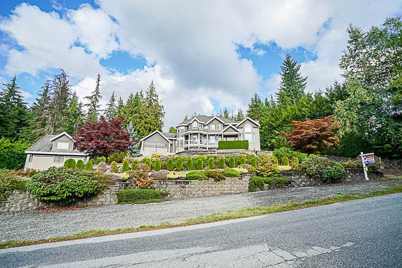 Welcome home to this luxurious 5800+ sq ft custom-built mansion situated above the hill of Anmore Estates! Over 1 acre property with breathtaking views of the Burrard Inlet & mountains. Features 18' vaulted ceilings, remote-controlled window blinds, central air conditioning and Japanese-imported hardwood. Master bedroom has huge walk-in closet and ensuite that includes Jacuzzi tub & pass-through fireplace. Basement features wet bar, pool table, media room, spacious gym and wine cellar that can fit over 3,000 bottles of wine! Attached double garage PLUS another detached garage for RV parking with upstairs workshop ready to be used as your man-cave. Massive backyard with beautiful patio and grass area. Too many features to list.