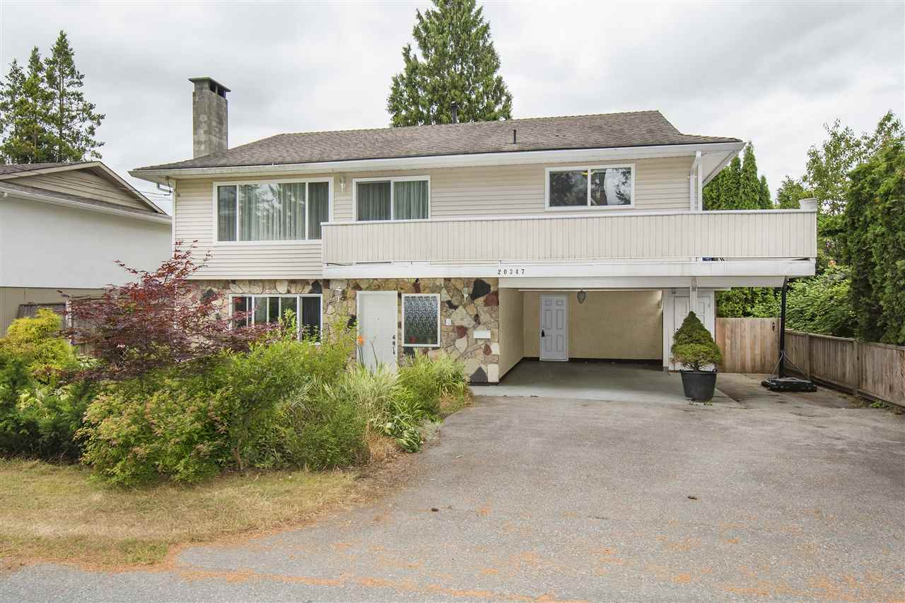Excellent Northwest LOCATION! Welcome to one of Maple Ridge's finest neighborhoods. This two level main floor entrance home is located on a no through street a mountain view. It is walking distance to the Westcoast Express, bus stops, shopping, schools, Golden Ears bridge, Allouette River, bike paths & many other amenities. This 4 bedroom home has lots of natural light with 3 renovated bathrooms, fresh paint, baseboards, crown moulding,new light fixtures, new water tank, steel exterior doors & double insulated vinyl windows. Upper level has a spacious living room, pot lights, wood burning F/P w/a sunny balcony off the kitchen. Nice rec rm down with 1 bdrm, 3 pce bath, with cast iron F/P and opens to a private deck & backyard is on a 6840 SF level lot. OPEN  SAT  Oct 14  2 to 4 pm