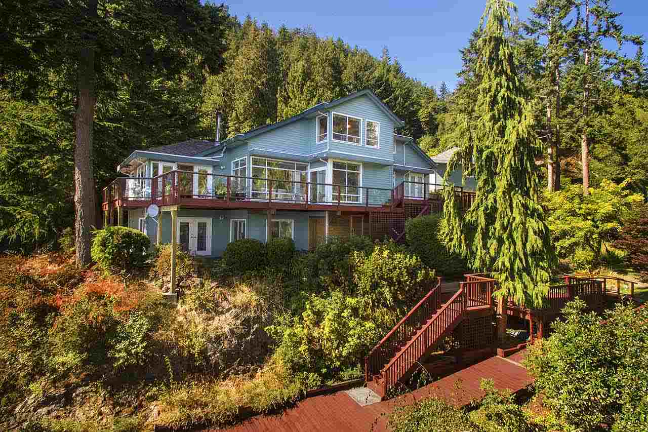Above the beach at September Morn, with an easy access trail to the waters edge.  This large, well maintained waterfront family home offers plenty of versatility, including 3 to 4 bdrms, 3 baths, a family room, spacious recreation room, and lots of storage. The property is a  place of peace, with a lovingly tended garden cascading down to the beach below. Decks surround 2/3's of the house and provide picturesque panoramas across the entrance to Howe Sound and beyond.