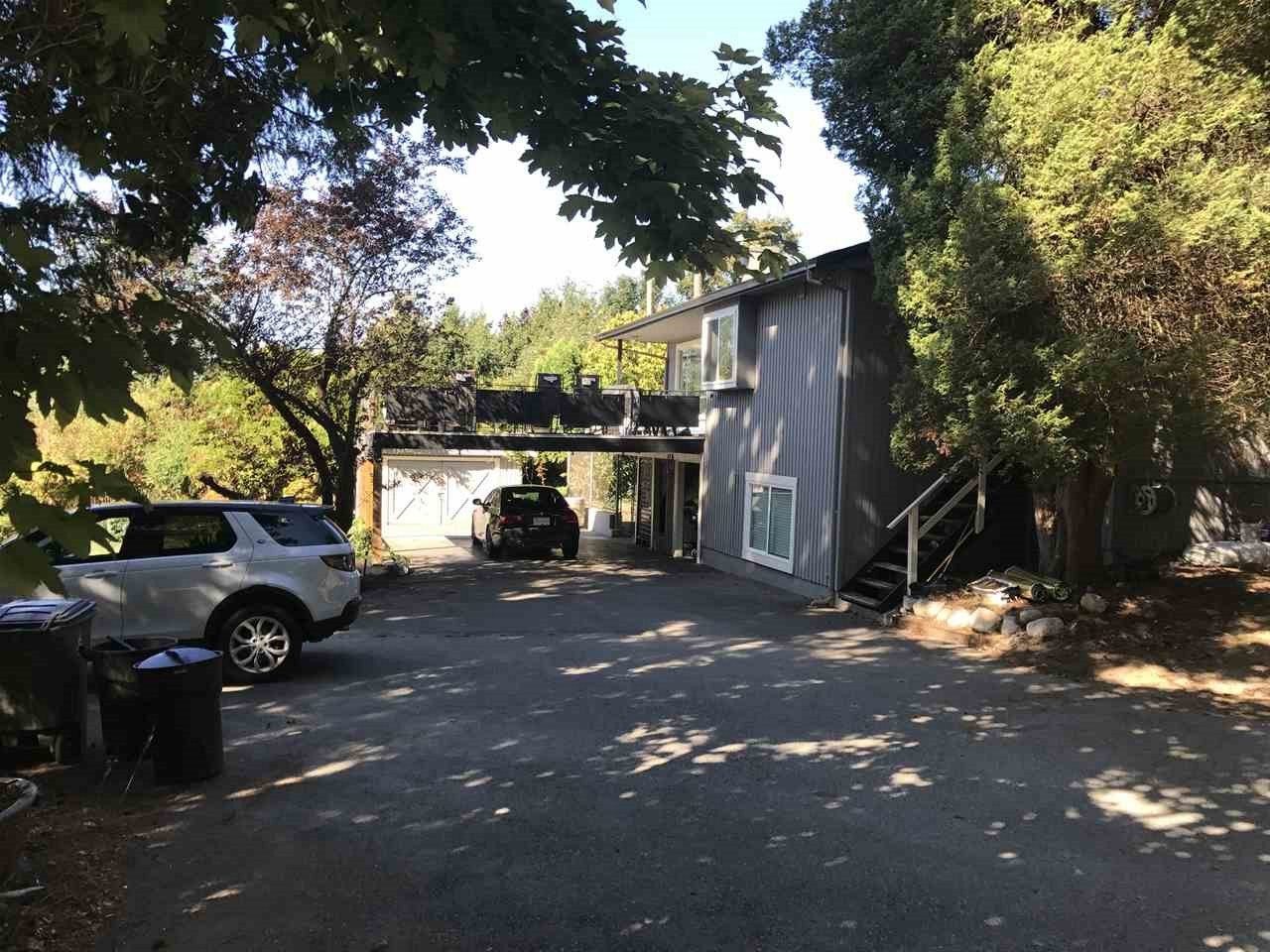 INVESTOR ALERT !!!This 1.183 acre property has potential for various lots. This land comes with a 3,184 sq.ft home. A seperate garage and a studio house. There is easy access to #10 highway very close to Kwantlen College, Martha Currie Elementary and Lord Tweedsmuir Secondary. Minutes away from both downtown Cloverdale and Langley, close to Cloverdale fairgrounds, transit and amenities.
