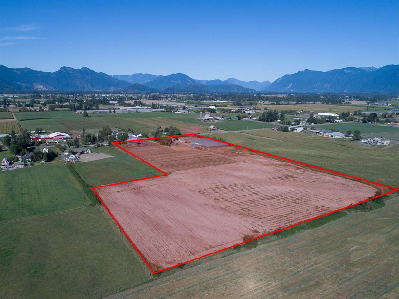 19.9 acres of prime farmland in East Chilliwack. Solid family home totaling 2,700 sq. ft. has 3 bedrooms and some recent updates including furnace, roof, flooring, and more. City water + 200' drilled well. Property offers multiple outbuildings including shop, barn, and greenhouses. Land suitable for blueberries, greenhouse expansion or other agriculture. Great location, only 3 kms from Hwy 1.