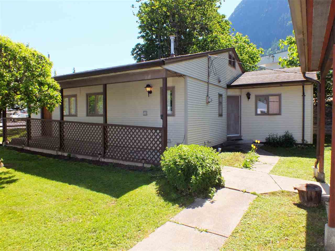 SOLID 2 BDRM 1-1/2 BATH 1248 SQ FT RANCHER WITH DETACHED 28X36 WORKSHOP, BEING SOLD WITH NEIGHBORING 1 BDRM 528 SQ FT BUNGALOW. MAIN HOME FEATURES CUSTOM WOOD TRIM, MANY BUILT -INS, RECENT ROOF, COVERED FRONT WALK AND 4 APPLIANCES. SHOP CONSISTS OF TWO STORAGE ROOMS AND 25X27 PARKING BAY OR WORKSPACE WHILE SMALL ADJACENT 1 BDRM HOME, ON ITS OWN PROPERTY, WOULD MAKE A GREAT INLAW DWELLING OR EASY CARE MORTGAGE HELPER. LOCATED JUST A FEW BLOCKS FROM DOWNTOWN CORE, REC FACILITIES AND GROCERY STORE THIS WOULD BE A FANTASTIC RETIREMENT, 1ST TIMER, INVESTMENT OR SHARED USE PURCHASE. TENANT IN SMALL HOME REQUIRES 24 HRS NOTICE AND MAIN HOME AND SHOP ARE VACANT FOR QUICK POSSESSION IF TENANT IN RENTAL TO STAY. ESTATE SALE BEING SOLD AS IS.