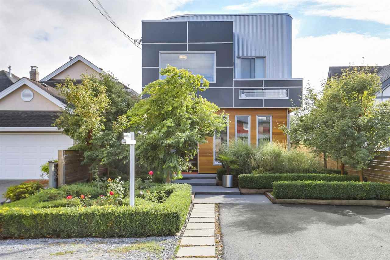 GREAT LOCATION IN THE HEART OF STEVESTON VILLAGE! Beautiful custom built home on a North facing 33 x 120 lot. 4 bdrm 3 1/2 baths featuring 2280 sq ft Luxurious living. Very Unique modern open plan, w/dramatic 10' high ceilings on both floors, no walls on main! Features include a gourmet Kitchen, Quartz counters, Jenn-Air stainless steel appliances, Polished concrete floors, hot water heat throughout, lots of built-ins 12' full opening eclipse door opening to back yard. Incredible panoramic views from the 1100  sq ft Roof Top Deck which includes a Hot Tub and lounging area furnished w/fire place! Great neighborhood, steps to Steveston Village & shops, Gary Point Park, West dyke & excellent schools - McMath Secondary & Lord Byng Elementary. A must see!