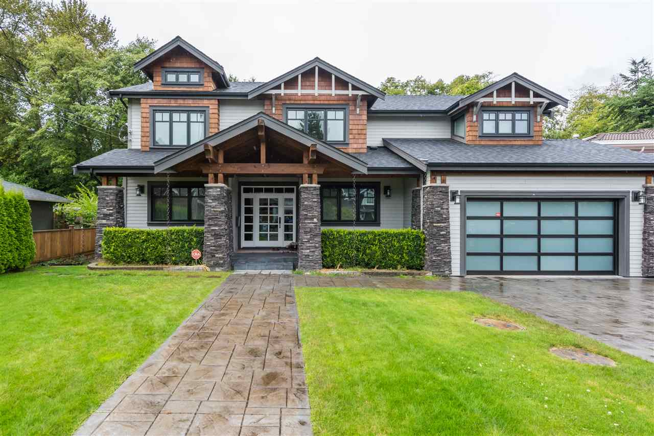 Custom designed home by Georgie Award-winning VictorEric Design Group, West coast contemporary with hardiplank, stone & cedar exterior. Westside Italian builder! Located in highly-desirable Garden Village on quiet, traffic-free street. Backs on to private greenbelt with stream! 3 kitchens, 7 bedrooms. Media room. Special mldg & trim, central A//CC, HRV. hardwood floors, quartz countertops in kitchen & baths, wok kitchen. Floor-to-ceiling windows, fully landscaped. Authorized suite. Radiant heating & 10' ceilings, superb layout & much more. Still in New Home Warranty. Close to Hwy 1, Metrotown, Brentwood, BCIT, Moscrop Secondary & parks. A must-see. Don't miss it.