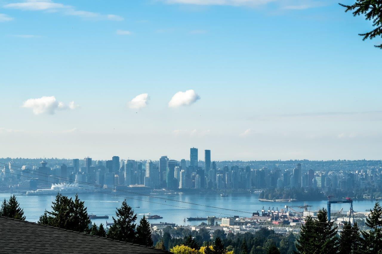 STUNNING CITY/OCEAN VIEWS - 4 BDRMS on main, 3 bdrms down, 4 bath. 2 huge decks, 345 SF & 316 SF. Suite below rented for approximately $2500/month. Upstairs rented for $2500 approx. Lane access from W Braemer as well. Totally UPDATED - need 36 hours notice for viewing. Note: Home is approx 4700 SF, lot 8400 SF approx.open sat 1 to 3p.m