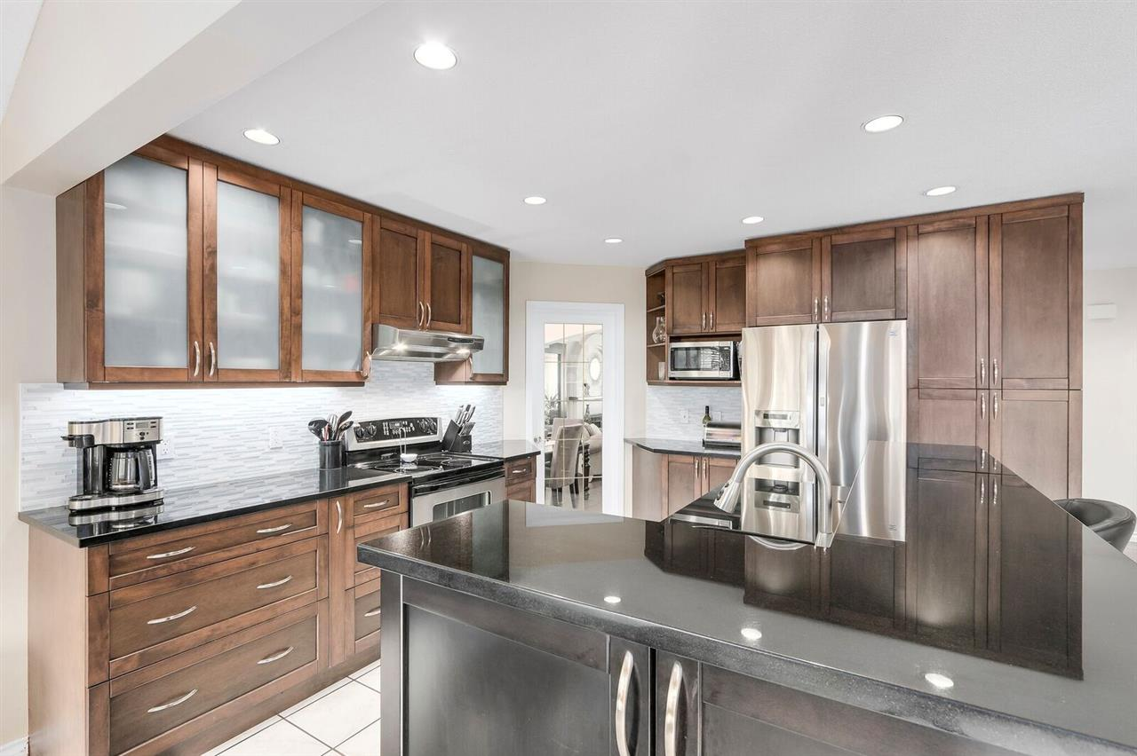 Prime location home in Fraser Heights on a quiet Cul-de-sac with a unbelievable walk score. Bright & well maintained, this home offers S. facing 2400+ sqft, 3 bdrm, den & updated 2 1/2 baths. Gorgeous foyer w/spiral staircase, new laminate, Lrg formal Lvg/Dng rm w/gas FP & vaulted ceilings. Beautiful updated kitchen w/tons of cupboards, SS appli, Granite counters, cool back splash & sit-up Island. Open concept to family rm, real HW floors, gas FP w/stunning wood cabinets. Slider to big deck, private sunny backyard w/new fence. Brand new roof & gutters, New H.E. Furnace, new front load W&D & huge 4' crawl space. Steps to Schools, parks, bus, shopping & close to Hwy 1, Pacific Academy & Guildford Mall. A must see. OPEN HOUSE SUN OCT 15 2-4PM