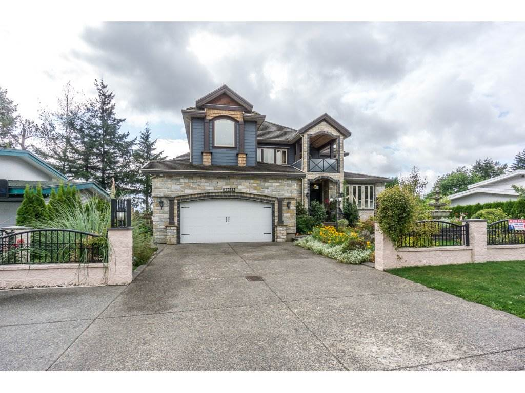 Come take a look at this Fabulous Custom built mega aprox.7300 sq.ft.-2 storey w/ basement home ! Outside finished with lots of Himlayan natural stones,hardy& concrete roof tiles.Main floor:gourmet maple kitchen with huge island , quartz counter tops thru-out,stainless steel appliances,2 kitchens ,engineered laminate floor,huge deck in the back area for entertaining ,3 bedrooms,2 full baths, laundry. Above floor:Total 4 bedrooms including 2 master bedrooms,7.1 internet sound system in main living room & in master bedrooms. Basement floor :2 bedroom legal suite & 3 more bedrooms & separate laundry rented $2700 month.Mortgage helper.Fenced yard,AIR- CONDITION.Located minutes away from Abbotsford Regional Hospital.
