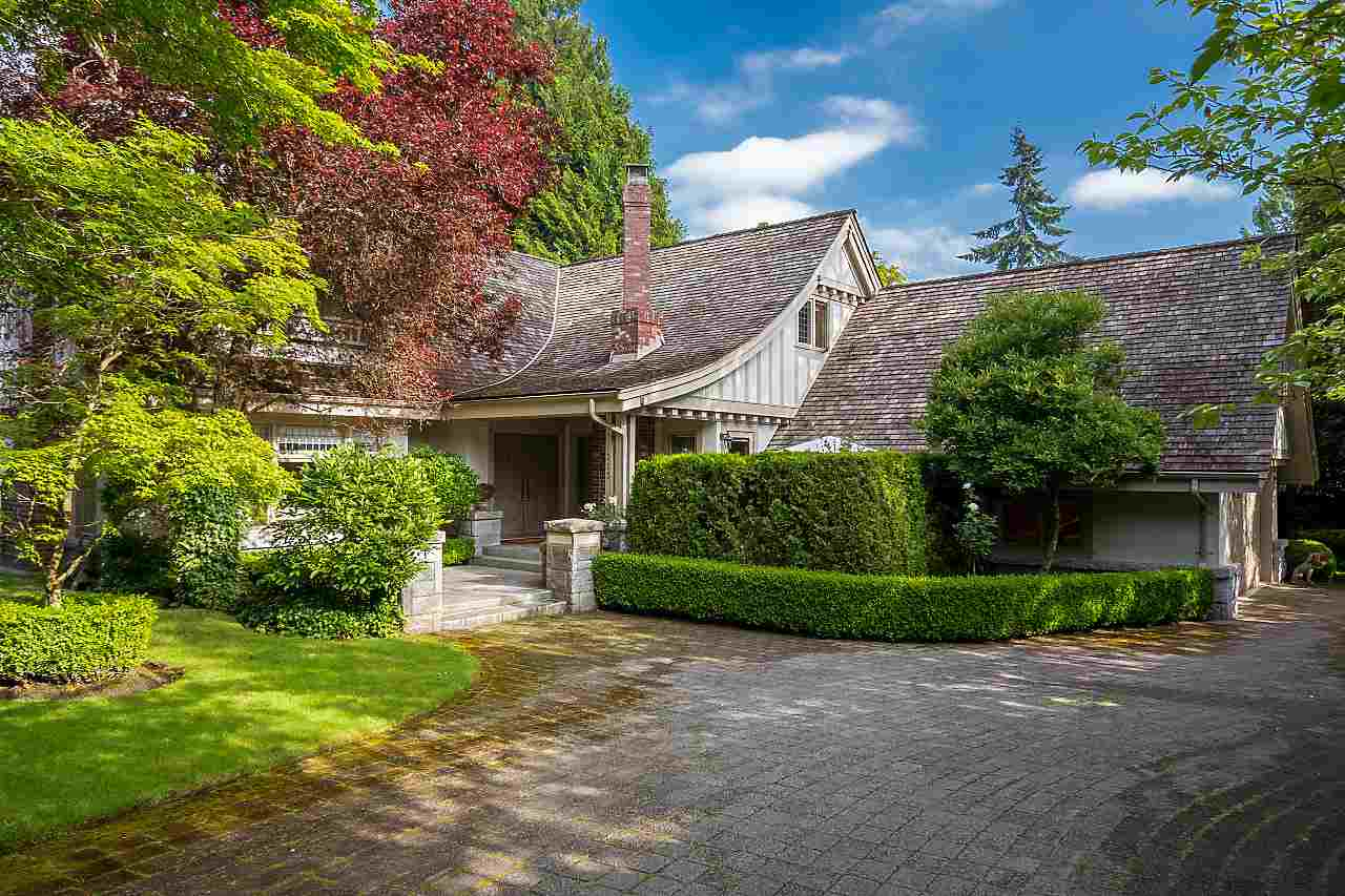 Nestled behind a private gated entry, amidst spectacular gardens, this hidden treasure offers tremendous privacy & serenity at Vancouver's most distinctive and prestigious address, in the heart of 1st Shaughnessy. Quality built in 1990, with extraordinary attention to detail, extensive mouldings, vaulted ceilings, Oak floors, custom cabinetry and in-floor radiant heat. Large principal rooms ideal for entertaining and relaxed family living. 3 bedrooms, office, playroom, kitchen, family room & dining room open to expansive patio. Attached 2 car garage and abundant storage. Close to South Granville shops, Van Lawn & Tennis Club and the best schools.