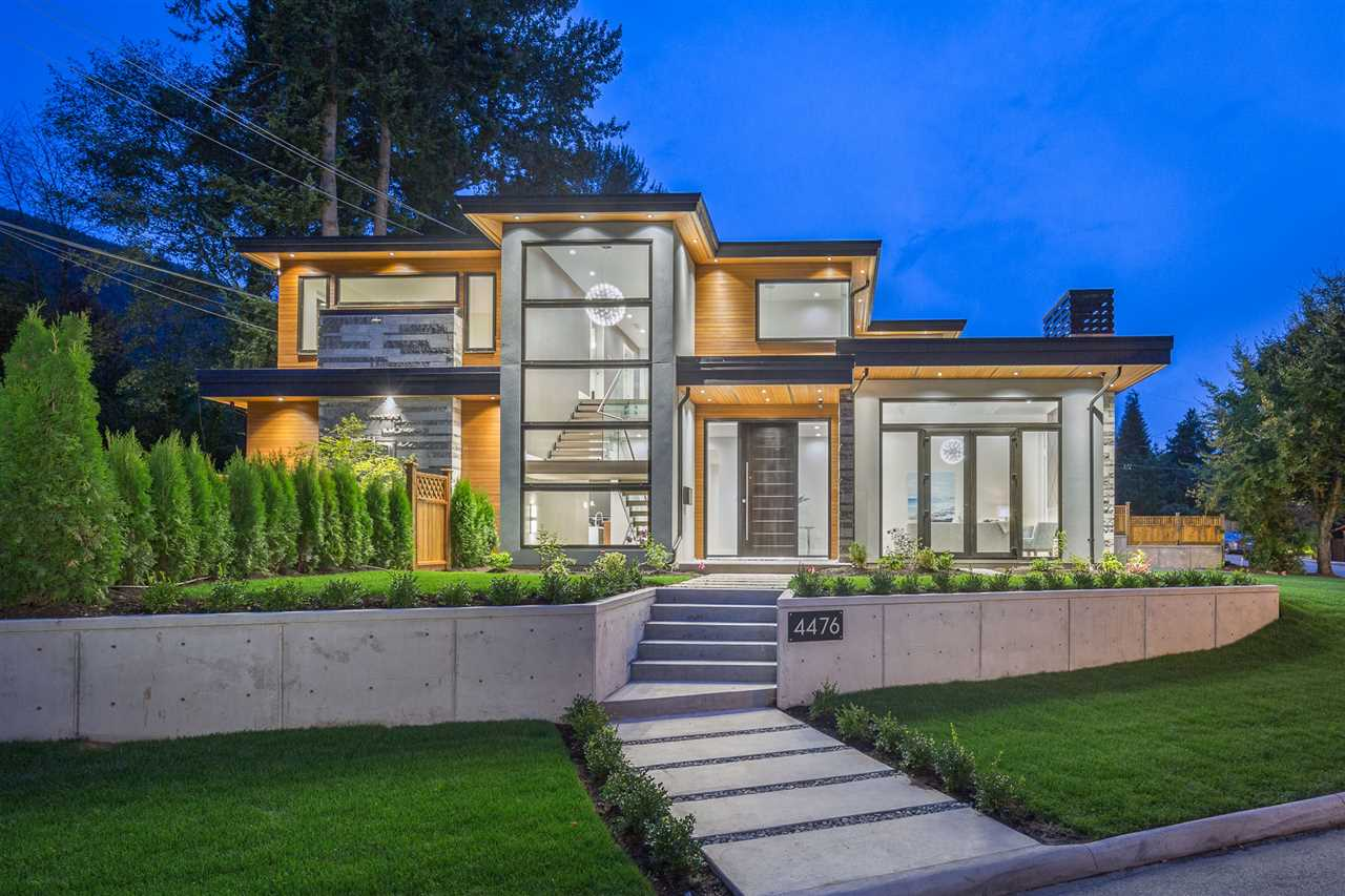 This beautiful Edgemont home captures your attention with a combination of superb workmanship and excellent design. The home boasts over 6,200 square feet on 3 levels, 6 bedrooms and 7 bathrooms on a 9,600 square foot lot. The main features a fabulous great room, stunning kitchen with high end Miele appliances, formal living room, wok kitchen, laundry room and office. Upstairs are 4 spacious bedrooms, all ensuited and a luxurious master. Downstairs in an entertainers dream a controlled wine room, bar, games area, rec room, media room, sauna as well as a 1 or 2 bedroom suite. Other features include HRV, AC and backup power, radiant heat and surround sound. Short 5 minute walk to Handsworth Secondary and Canyon Heights Elementary. Come see for yourself!