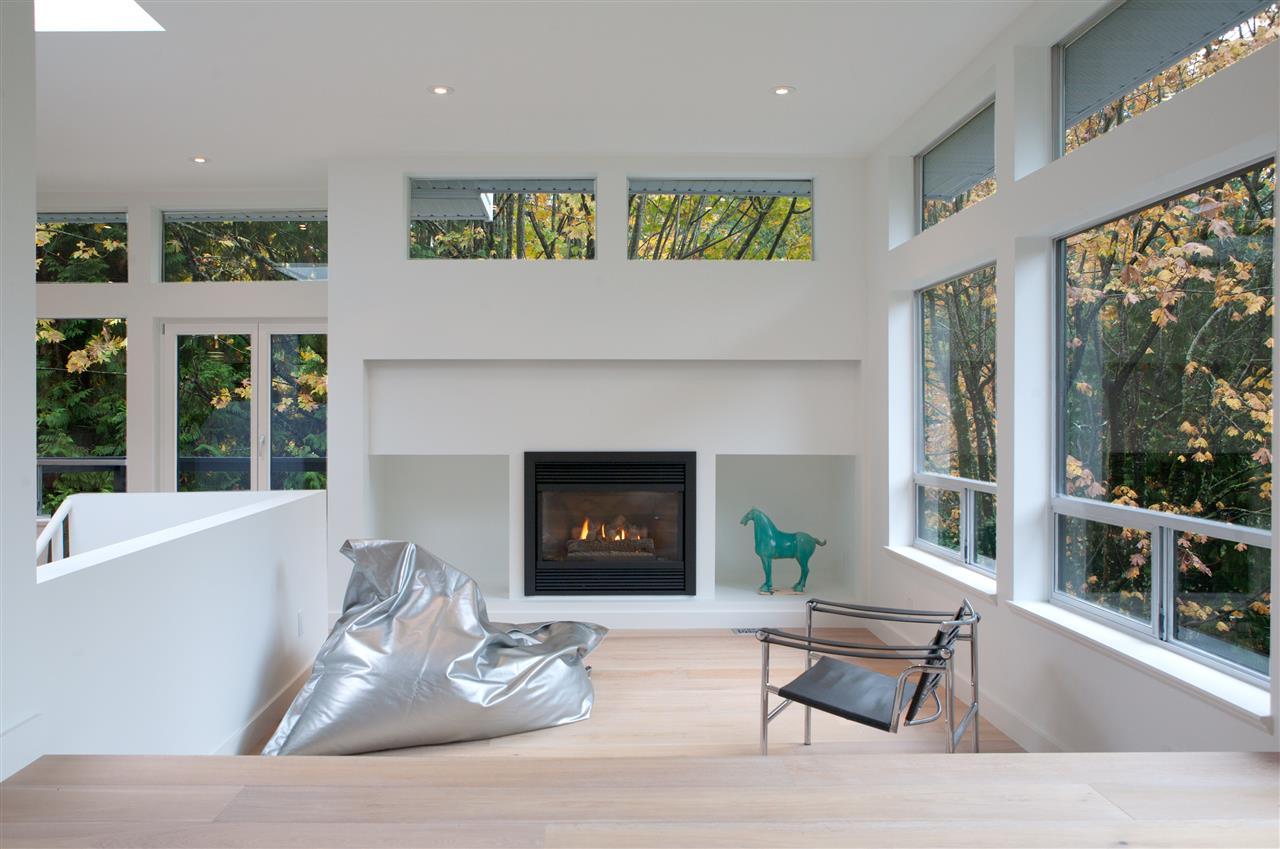This stunning home of renowned Architect and designer Anja Henche, ah design was featured for the 2nd year in a row on the Vancouver modern home tour and will be featured as part of western hiving Design week. With only steps to the beach and West Vancouver Yacht Club. The open plan is bright with main level features of skylights/ windows all around/gas fire a completely renovated gorgeous kitchen with white oak wide plank flooring, Wolf/Subzero appliances, granite counter tops, stunning cabinetry.   This home features three/four bedrooms, and two full bathrooms. A gorgeous yard, three sun decks and an outdoor hot hub and shower for relaxing in the tranquil surroundings. Plus a bonus studio. Open sat and sun 2-4 pm