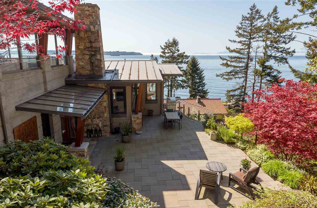 Spectacular setting! One of the most beautiful homes, including the quiet end of the lane location, in West Vancouver! Only 10 years old, architecturally custom designed, by award winning Rositch Hemphill Architects. Ocean views are incredible, south facing, unobstructed ocean views with sun all day, this open plan home offers 4 bedrooms, 4 bathrooms, office, expansive recreation room with over height ceilings, wine room, utility room, and plenty of storage. VERY private, with over 4,000 sf, metal roof, wood windows, eclipse doors and french doors all with a level of quality rarely seen. Elevator has been roughed in if new owner desires to install! Gated secure property and wonderfully landscaped with a coy pond just for fun.